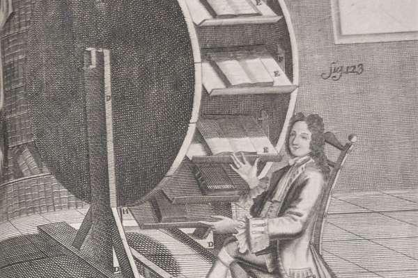 A Man Sitting at a Bookwheel