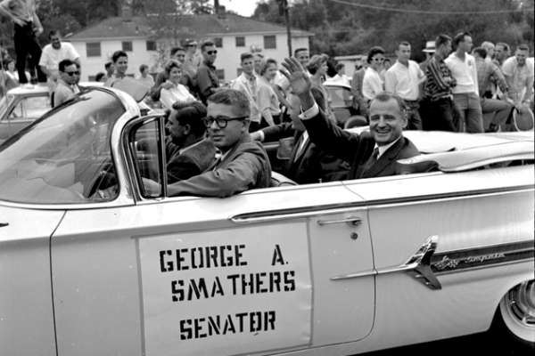 George A. Smathers in a car in UF Homecoming Parade